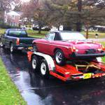 MGB loaded up and ready to go despite the rain and