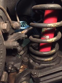Left front suspension locked to right.JPG
